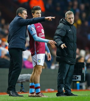 Aston Villa manager Remi Garde talks to Jack Grealish as he prepares to come on.