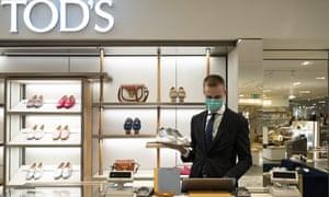 shoe shop assistant wearing face mask