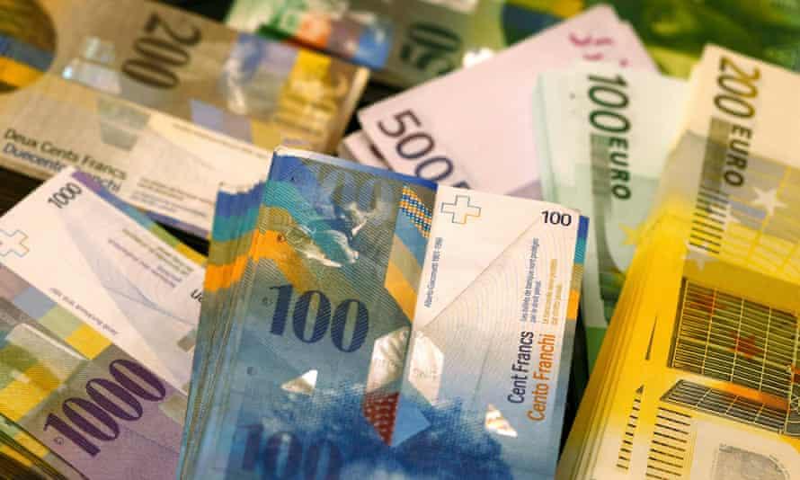 Swiss franc and Euro banknotes.