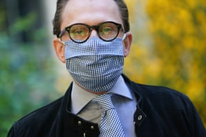 Jan-Henrik Scheper-Stuke, a tailor, shows off his matching check tie and face mask in Berlin, Germany