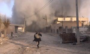 Smoke rises after Russian airstrikes on Saraqib, Idlib province, 6 February.