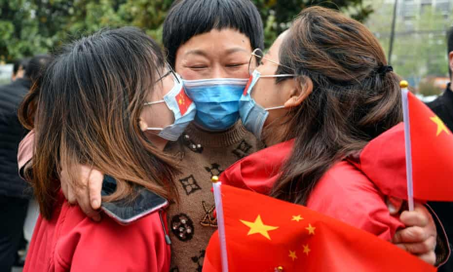 Medical staff kiss their relative after returning home from Wuhan helping with the coronavirus effort, in Bozhou, in China's eastern Anhui province.
