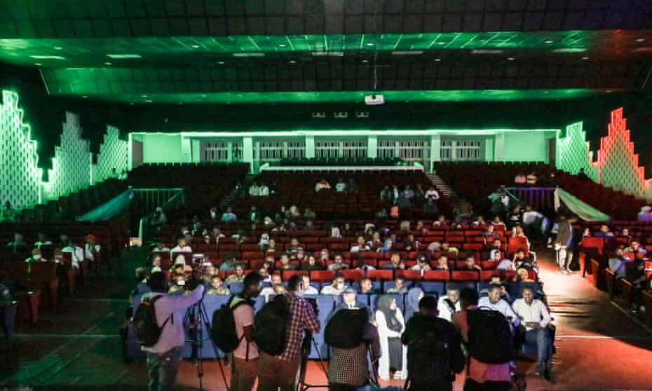 Photographers document the audience on a historic night as Somalia's National Theatre hosts its first film screening since 1991.