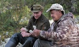 Putin and Shoigu examine the local flora