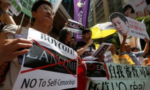 Protesters, holding up a portrait of a Denise Ho, demonstrate outside the shopping mall in Hong Kong.