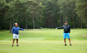 Members at Pine Ridge Golf Club ensure the 2 meter social distance as they begin their round as golf resumes in England.