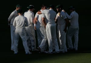 The Aussie players celebrate after Broad was out.