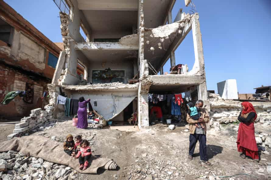 Families seek refuge in the ruins of Idlib, a Syrian city.