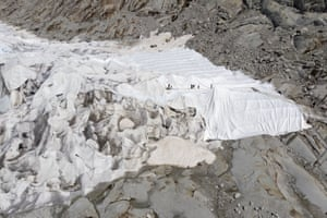 People cover the Rhone Glacier in blankets at the glacial lake above Gletsch near the Furkapass in Switzerland.