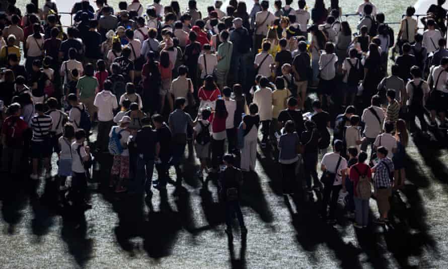 Go with the crowd … people play Pokémon Go at Yokohama Stadium in Japan.