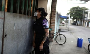 A police officer from Rio de Janeiro's Maria da Penha patrol, which specialises in tackling domestic violence.