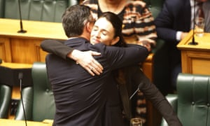 Jacinda Ardern embraces James Shaw in parliament after MPs joined forces across the aisle to pass a bill aimed at combating climate change.