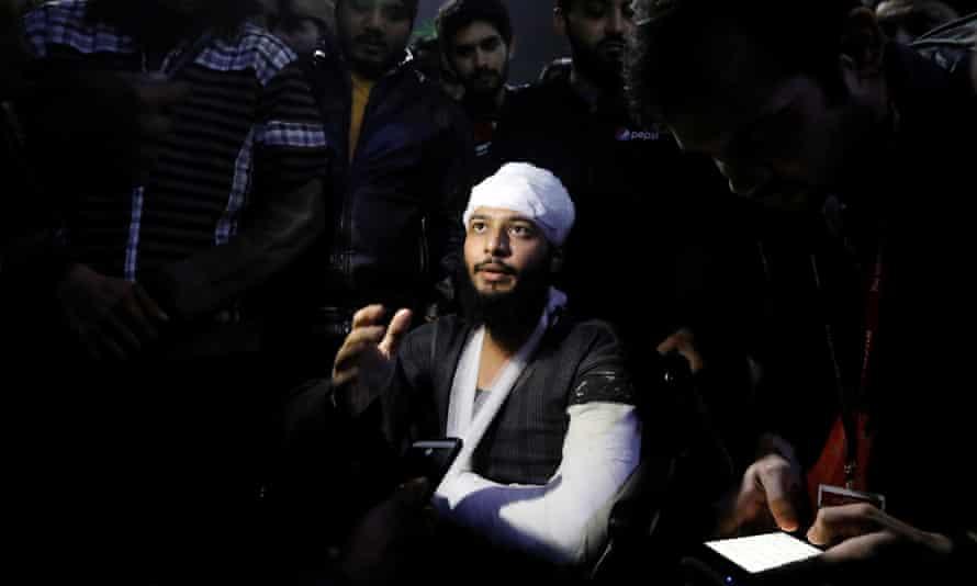 Hisham Siddiqui talks to media outside Alshifa hospital in Delhi.
