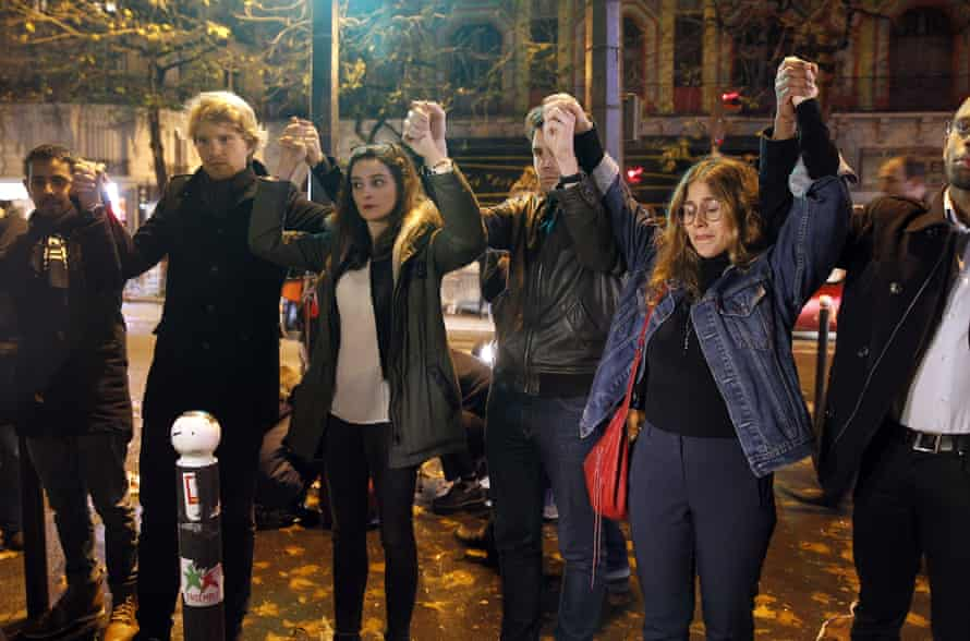 Paris, 20 November 2015: people gather at a memorial to the victims near the Bataclan theatre.
