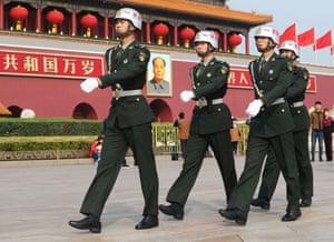 Chinese paramilitary policemen patrol the Tian'anmen Square