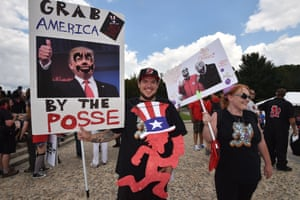 Fans of the US rap group Insane Clown Posse, known as Juggalos, hold placards mocking US President Donald Trump during a protest on September 16, 2017 near the Lincoln Memorial in Washington, D.C. against a 2011 FBI decision to classify their movement as a gang. / AFP PHOTO / Paul J. RichardsPAUL J. RICHARDS/AFP/Getty Images