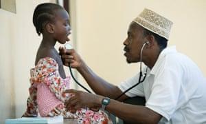 Doctor checks a child in Tanzania