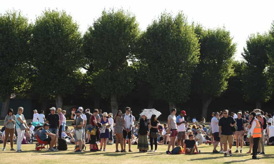 Members of the public queue for tickets outside The All England Tennis Club in Wimbledon, southwest London, on July 1, 2018, on the first day of the 2018 Wimbledon Championships tennis tournament