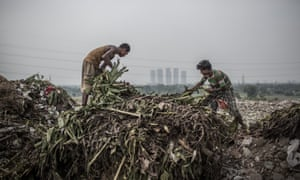 Two young scavengers are picking waste