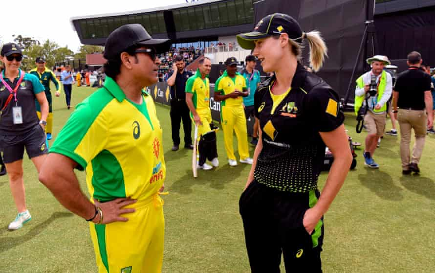 Sachin Tendulkar speaks with Ellyse Perry before a celebrity match to raise funds for those affected by the Australian bushfires, in Melbourne last February.