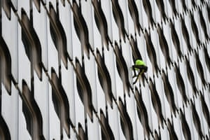 Paris, France: The urban climber Alain Robert, popularly known as the French Spiderman, climbs the 152-metre (499ft) Tour Ariane skyscraper in La Défense, a business district west of Paris