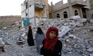 Women walk through the debris of a housing block allegedly destroyed by Saudi-led airstrikes in Sana''a, the capital of Yemen