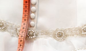 Measuring tape and a wedding dress