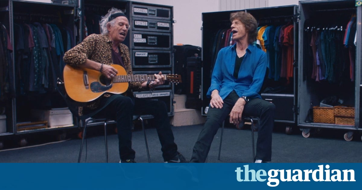 Watch the Rolling Stones sing Country Honk acoustic ...