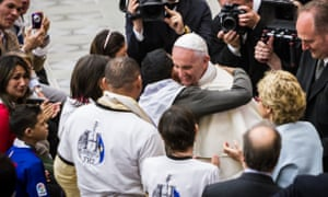 The pope embraces and blesses families with Huntington's at the Vatican.