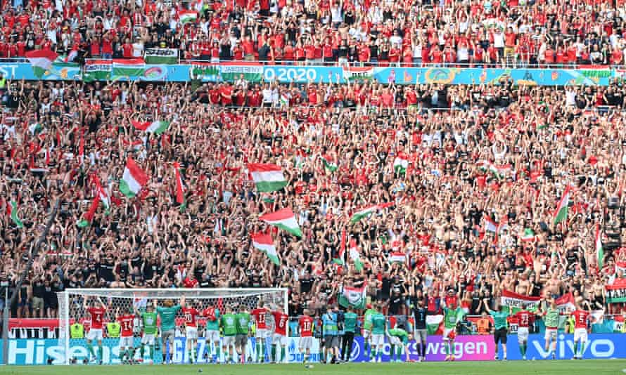 Hungary players salute the fans at a packed-out Puskas Arena.