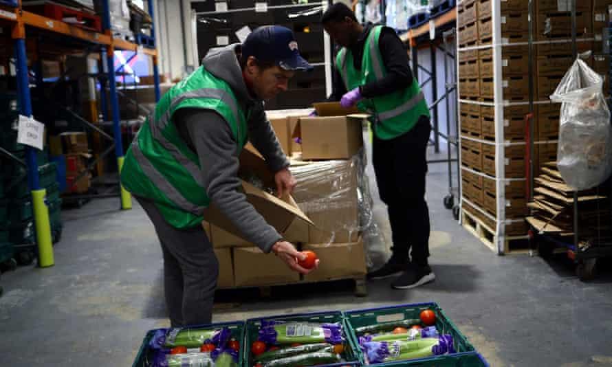 Volunteers sort food at a FareShare redistribution centre in Deptford, south-east London.