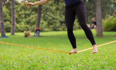 tightrope with woman balanced on it