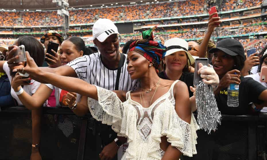 Naomi Campbell greets the crowds at the concert.