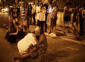 Rio de Janeiro, Brazil People cry at the spot where council member Marielle Franco and her driver were shot