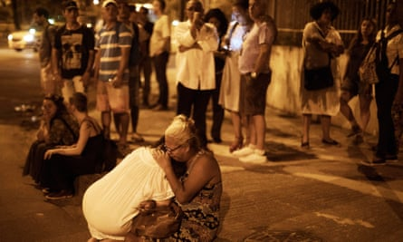 People react at the scene where Marielle Franco and her driver have were shot to death in Rio de Janeiro, Brazil, on 15 March. Police believe militias were involved.
