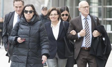 Nancy Salzman, center, leaves Brooklyn Federal court, on Wednesday.