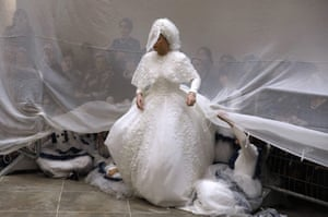 Bride Hana Ritza of the Premishlan Hasidic dynasty stands during the Mitzvah Tantz, a Hasidic custom is which the men dance before the bride on the wedding night. Bnei Brak, Israel