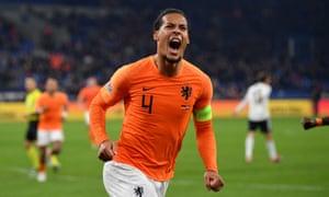 Virgil van Dijk celebrates after scoring the late equaliser that put the Netherlands on top of the group.