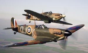 A Spitfire (front) flying alongside a Hurricane from the Battle of Britain Memorial Flight, over RAF Coningsby.