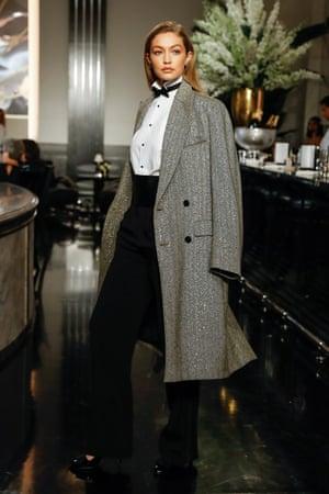 Gigi Hadid in bowtie and overcoat.