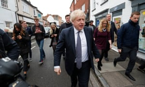 British Prime Minister Boris Johnson walks through the High Street during a General Election campaign stop in Wells on November 14, 2019 in Somerset, England.