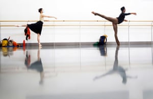 Two female dancers at the barre