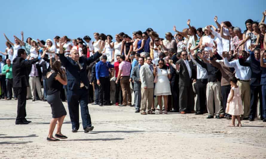 Bishop Ricardo Pereira of the Methodist Church of Cuba (centre) celebrates during the protest.
