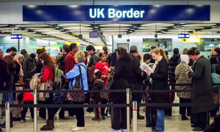 Queue at passport control, UK airport, Gatwick.