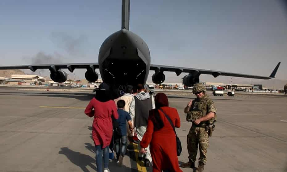 Afghans board an RAF flight to the UK at Kabul airport