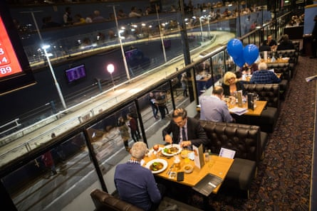 People dine in the Grandstand restaurant.