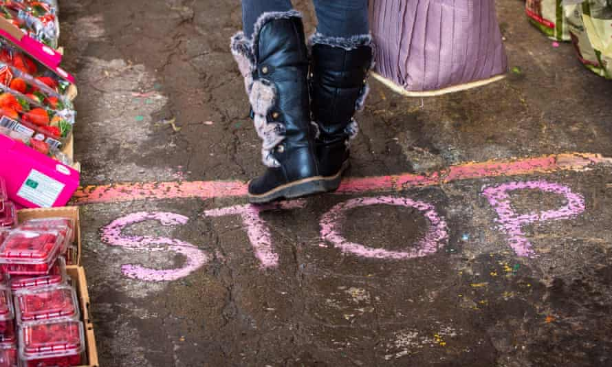 'Stop' chalked on the floor of a fruit and vegetable shop