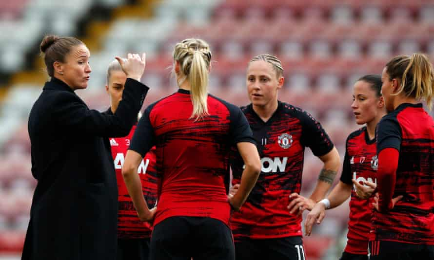 Casey Stoney talks to her players before the derby against Manchester City in November.