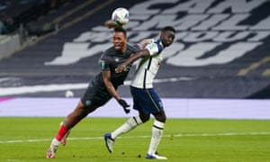 Ivan Toney of Brentford gets a header in on goal ahead of Davinson Sánchez of Tottenham Hotspur.