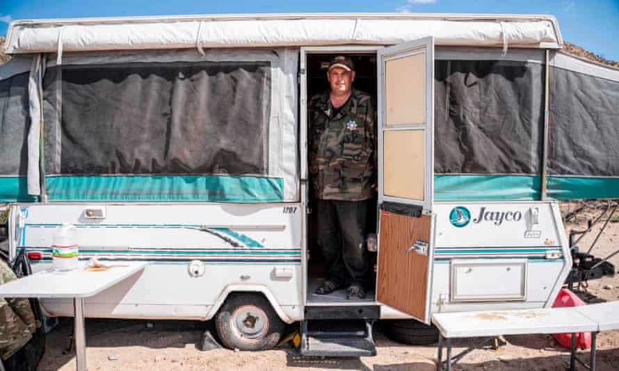 United Constitutional Patriots member Jim Benvie, 43, stands in a camper near the US-Mexico border wall in Anapra, New Mexico, on 20 March 2019.